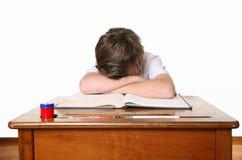 Écolier avec la tête dans des mains photo libre de droits