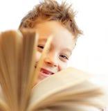 Écolier avec le livre photos stock