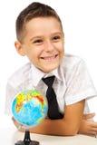 Écolier avec un globe Photo libre de droits