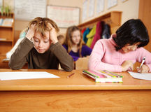Écolier confus Photos libres de droits