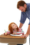 Écolier de aide adulte au bureau Images stock
