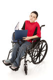 Écolier de l'adolescence dans le fauteuil roulant Photo stock