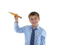 Écolier de sourire retenant un crayon Images libres de droits