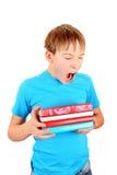 Écolier fatigué baîllant Image stock