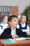 Écolier mignon sur la leçon réelle Photographie stock libre de droits