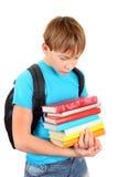 Écolier triste avec livres Photos libres de droits