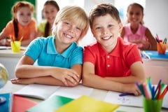 Écoliers amicaux Images stock