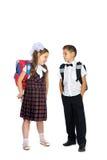 Écoliers avec des sacs d'école Image libre de droits