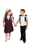 Écoliers avec des sacs d'école Photographie stock libre de droits