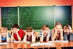 Écoliers fatigués Images libres de droits