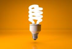 Économie d'énergie d'Eco sur le fond orange Photographie stock
