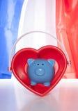 Économie d'amour sur un drapeau français Photos libres de droits