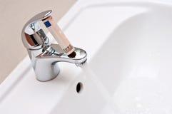 Économie de l'eau photographie stock
