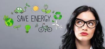 Économisez l'énergie avec la jeune femme d'affaires photographie stock libre de droits