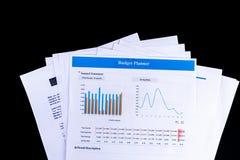 Économisez le papier de documents de bilan de planificateur avec le backgrou noir image stock