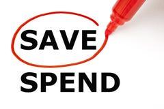 Économisez ou dépensez avec le marqueur rouge photographie stock
