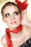 Écoute blonde en rouge Images libres de droits