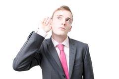 Écoute d'homme d'affaires images stock