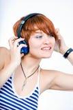écoutent la musique image libre de droits