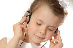 Écouter la musique photographie stock