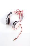 Écouteur blanc sur le fond blanc Image libre de droits