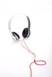 Écouteur blanc sur le fond blanc Photographie stock