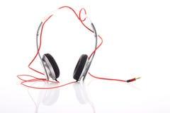Écouteur blanc sur le fond blanc Photo stock