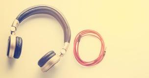Écouteur noir avec le cric de câble dans le ton de vintage Photographie stock