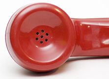 Écouteur rotatoire rouge antique de téléphone Photo stock