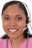 Écouteur s'usant de beau réceptionniste médical images stock
