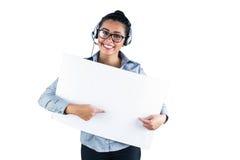 Écouteur s'usant de sourire de femme d'affaires images libres de droits