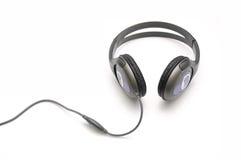 Écouteurs avec le câble noir d'isolement Images stock