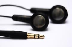 Écouteurs avec le cric Photographie stock