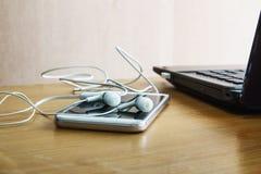 Écouteurs blancs Photos libres de droits