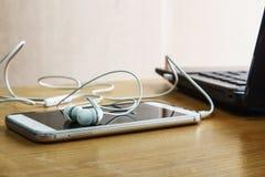 Écouteurs blancs Photographie stock