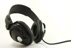 Écouteurs d'isolement Photographie stock libre de droits