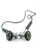 Écouteurs d'isolement sur le blanc Photo libre de droits