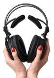 Écouteurs dans des mains Photo libre de droits