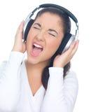 écouteurs de fille Photos stock