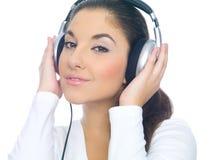 écouteurs de fille Photographie stock libre de droits