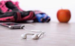 Écouteurs et équipement de sport Photo libre de droits