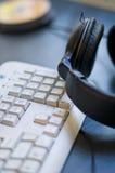 Écouteurs et clavier images stock