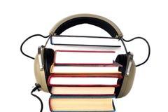 Écouteurs et livres de vieux type Photographie stock libre de droits