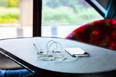 Écouteurs et media de téléphone Photographie stock libre de droits