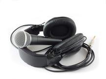 Écouteurs et microphone au-dessus de blanc Photos libres de droits