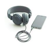 Écouteurs et téléphone portable gris de vintage Images stock