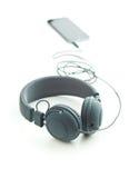Écouteurs et téléphone portable gris de vintage Image stock