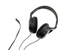 Écouteurs noirs d'isolement Photographie stock