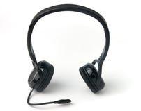 Écouteurs noirs d'isolement sur un fond blanc Image libre de droits
