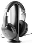 Écouteurs noirs sur le stand Photographie stock libre de droits